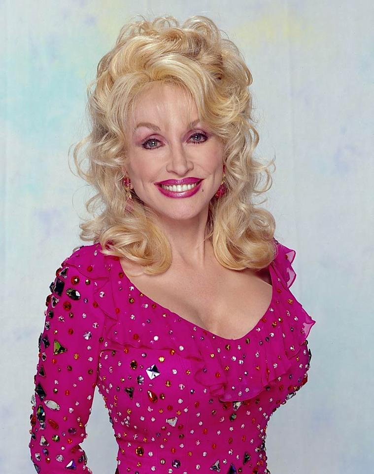 <b>2000:</b> Looking as doll-like as ever, Parton was decked out in fuchsia for her appearance on Bette Midler's CBS sitcom. CBS/Landov - September 29, 2000 DateCreated: 20000929 :