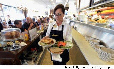 diner waitress carrying plates of food