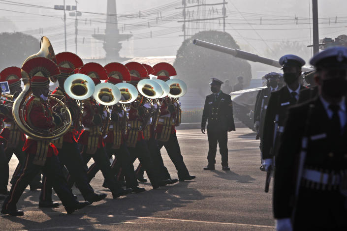 An Indian Army brass band marches during rehearsals for the upcoming Republic Day parade in New Delhi, India, Thursday, Jan. 21, 2021. Republic Day marks the anniversary of the adoption of the country's constitution on Jan. 26, 1950. Thousands congregate on Rajpath, a ceremonial boulevard in New Delhi, to watch a flamboyant display of the country's military power and cultural diversity. (AP Photo/Manish Swarup)
