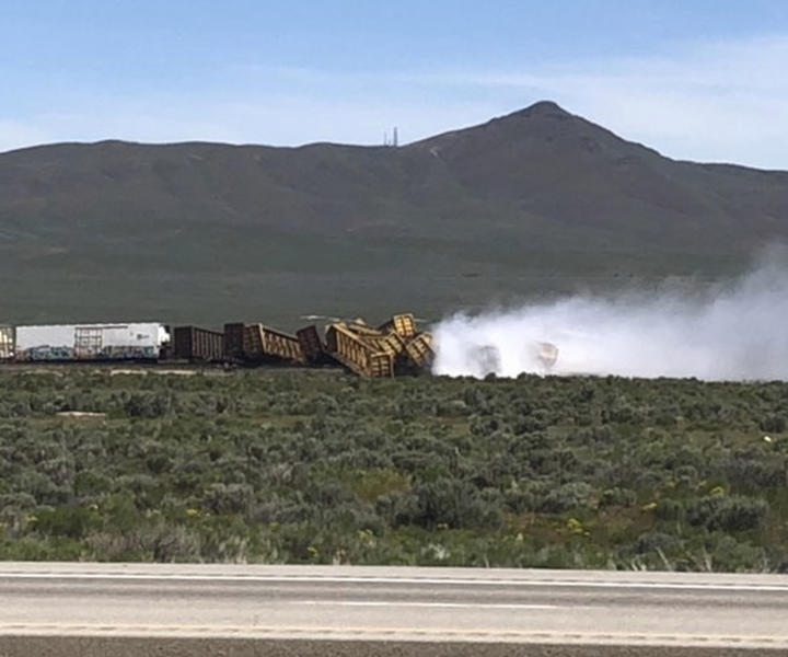 In this photo provided by Michael Lyday shows a train derailment and potential hazardous materials spill east of Wells, Nev., Wednesday, June 19, 2019. A 60-mile stretch (96 kilometers) of U.S. Interstate 80 in northeast Nevada has been closed while emergency crews respond to the train derailment and potential hazardous materials spill east of Wells. (Michael Lyday via AP)
