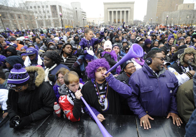 Baltimore Ravens fans blow horns during a victory ceremony at City Hall Tuesday, Feb. 5, 2013 in Baltimore. The Ravens defeated the San Francisco 49ers in NFL football's Super Bowl XLVII 34-31 on Sunday. (AP Photo/Gail Burton)