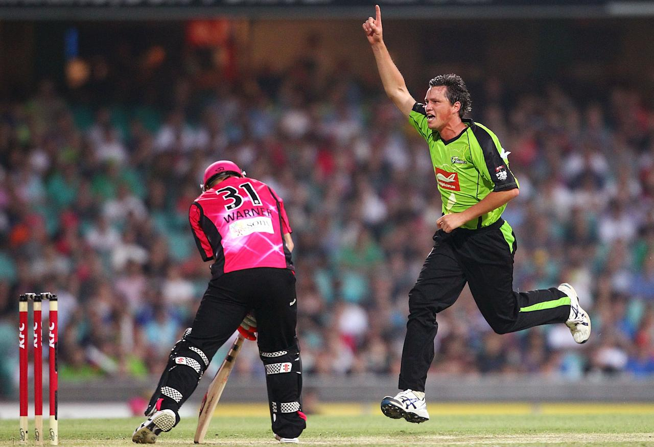SYDNEY, AUSTRALIA - DECEMBER 08:  Chris Tremain of the Thunder celebrates getting the wicket of David Warner of the Sixers during the Big Bash League match between the Sydney Sixers and the Sydney Thunder at Sydney Cricket Ground on December 8, 2012 in Sydney, Australia.  (Photo by Mark Nolan/Getty Images)