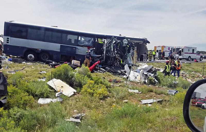 The Latest: Police: Blowout caused fatal crash involving bus