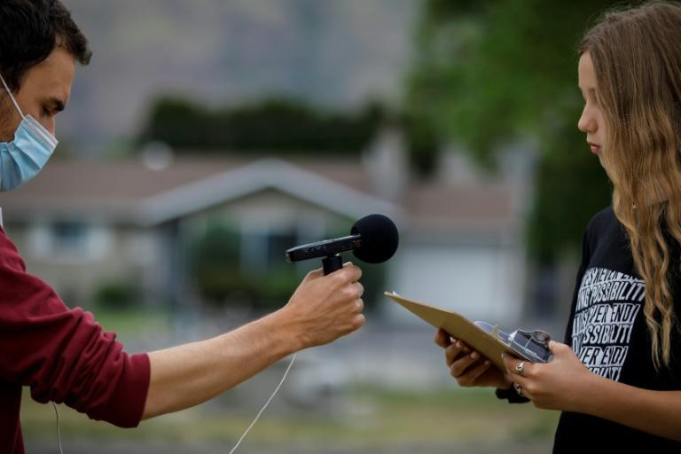 Nicolas Rausch of the Kamloops Francophone association records students speaking about the history of Canada's residential school system at École Collines-D'or in Kamloops, western Canada, on June 3, 2021