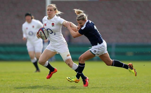 Rollie (righr) admits it is hard for Scotland to compete with England's full-time players
