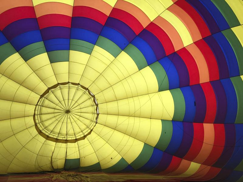 A hot air balloon inflates in Albuquerque, N.M., on Tuesday, Oct. 1, 2019. The annual Albuquerque International Balloon Fiesta is expected to draw several hundred thousand spectators and hundreds of balloonists from around the world. It will kick off Oct. 5 with a mass ascension. (AP Photo/Susan Montoya Bryan)