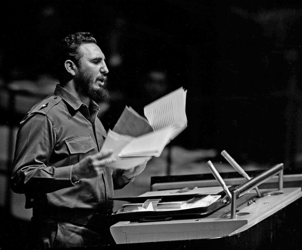 <p>Cuban Premier Fidel Castro waves a document during his talk to the United Nations General Assembly, Sept. 26, 1960. (AP Photo) </p>