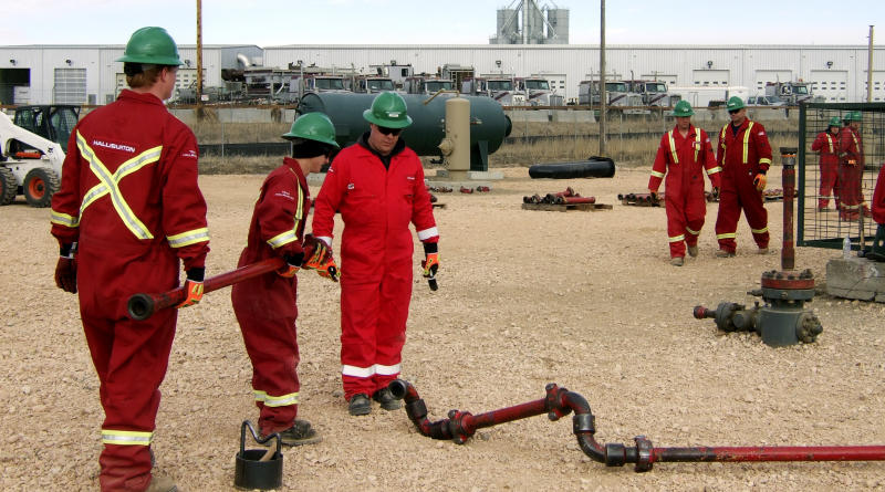 FILE - In this Feb. 22, 2012, file photo, Halliburton employees receive training from Williston State College's Train ND program,  in Fargo, N.D. Halliburton Co. said Wednesday, Oct. 17, 2012, its third-quarter net income fell 12 percent as drilling activity declined and costs rose in its core North American business. The Houston energy services company earned $602 million, or 65 cents per share, down from $683 million, or 74 cents per share, a year ago. (AP Photo/Forum Communications Co., Amy Dalrymple)