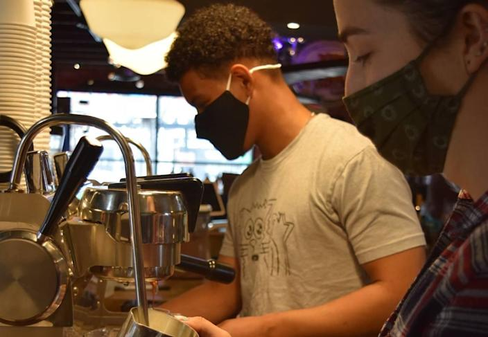 Baristas at Smelly Cat Coffeehouse & Roastery, normally a prime place to make connections, have seen customers adapt to a new normal during COVID-19.