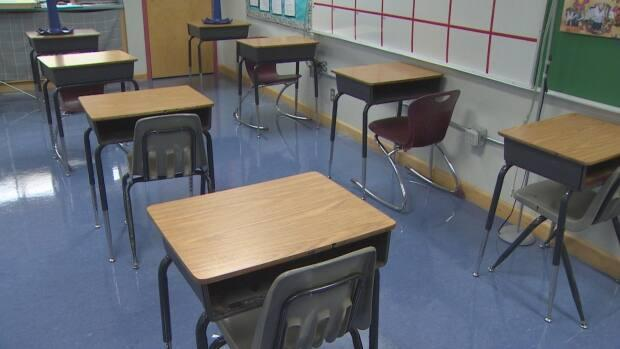 Desks, spaced out to allow for physical distancing, inside Yellowknife's Range Lake School. Further north, in the Beaufort Delta, students are being celebrated for scoring well on a Canadian assessment test.  (Randall McKenzie/CBC - image credit)