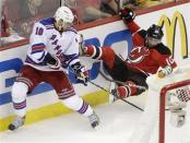 New York Rangers right wing Marian Gaborik, left, of Slovakia, collides with New Jersey Devils defenseman Peter Harrold during the first period of Game 3 of an NHL hockey Stanley Cup Eastern Conference final playoff series, Saturday, May 19, 2012, in Newark, N.J. (AP Photo/Frank Franklin II)