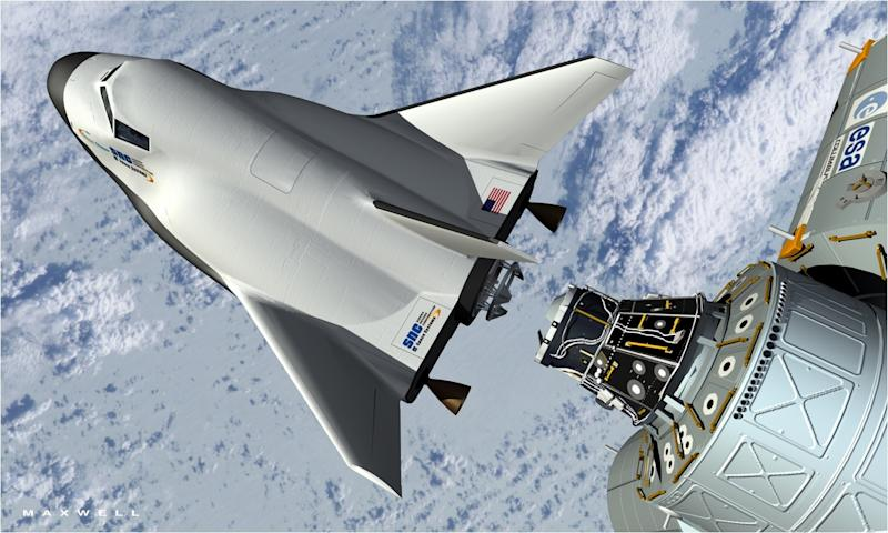 This artist's rendering provided by Sierra Nevada Space Systems shows the company's Dream Chaser spacecraft docking with the International Space Station. The company hopes  that by 2014 the Dream Chaser will makes its first orbital flight and then eventually take space travelers to the International Space Station. NASA's effort to farm out astronaut trips to the International Space Station to private companies over the next decade is under fire again, this time by federal deficit hit men. (AP Photo/Sierra Nevada Space Systems)