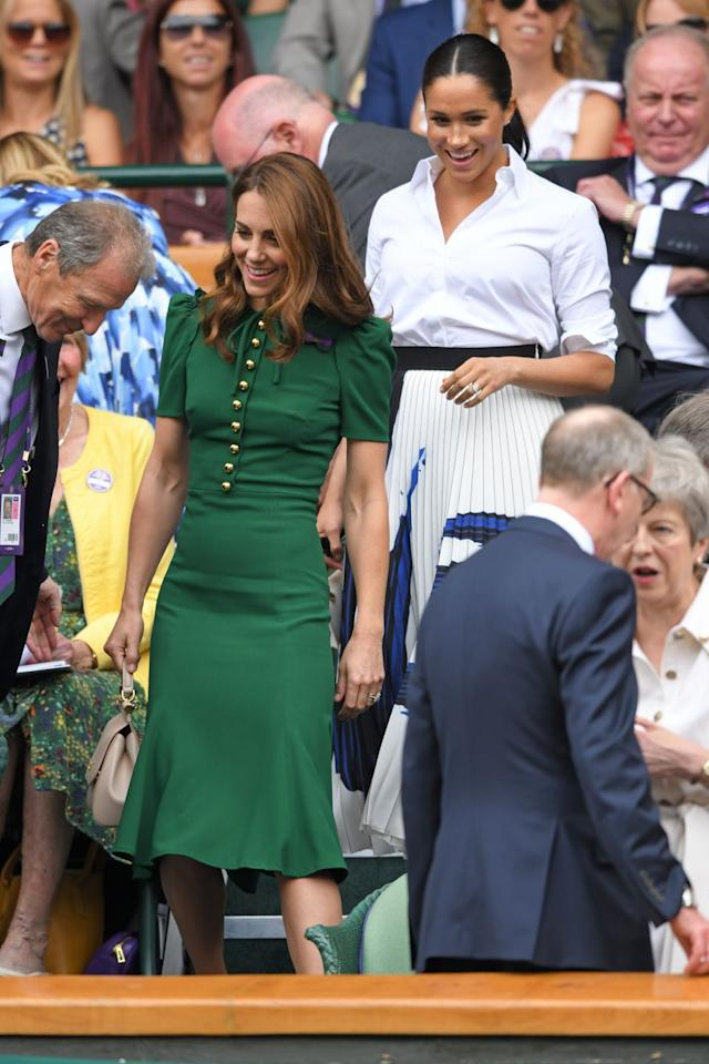 <p>All smiles as they take their seats in the Royal Box.</p>