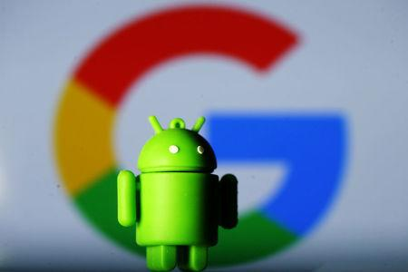 A 3D printed Android mascot Bugdroid is seen in front of a Google logo in this illustration