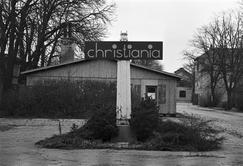 """FILE - In this 1971 file photo a view of a Christiania sign erected after squatters moved into a former navy barracks in 1971 and called it Christiania, in Copenhagen, Denmark. Copenhagen's Christiania neighborhood is turning 50 and after years of not always peaceful coexistence with the authorities, the counter-culture enclave wants to maintain its reputation as a """"free-wheeling society"""" of hash dealers, political idealists, and aging hippies. One resident says the oasis has"""" become more and more an established part"""" of the Danish capital. It all started in 1971, when a small counterculture newspaper needed an outrageous story for its front page and staged an """"invasion"""" of an abandoned 18-century navy base. (Lars Hansen/Ritzau Scanpix via AP, File)"""