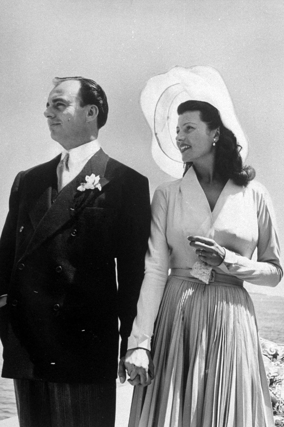 <p>Even though he had a reputation as a playboy, Prince Aly Khan set his sights on Hollywood actress Rita Hayworth shortly after her divorce to director Orson Welles. After being introduced while vacationing on the French Rivera, Hayworth and Aly Khan returned to France in 1949 and were married in a particularly lavish ceremony at the l'Horizon. </p>