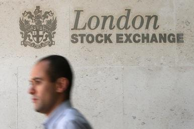 City workers pass the London Stock Exchange building on September 19 2008 in London, England.