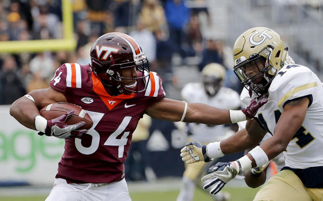 "Virginia Tech's <a class=""link rapid-noclick-resp"" href=""/ncaaf/players/243681/"" data-ylk=""slk:Travon McMillian"">Travon McMillian</a>, left, runs the ball against Georgia Tech's <a class=""link rapid-noclick-resp"" href=""/ncaaf/players/229997/"" data-ylk=""slk:Corey Griffin"">Corey Griffin</a> in the second quarter of an NCAA college football game in Atlanta, Saturday, Nov. 11, 2017. (AP Photo/David Goldman)"