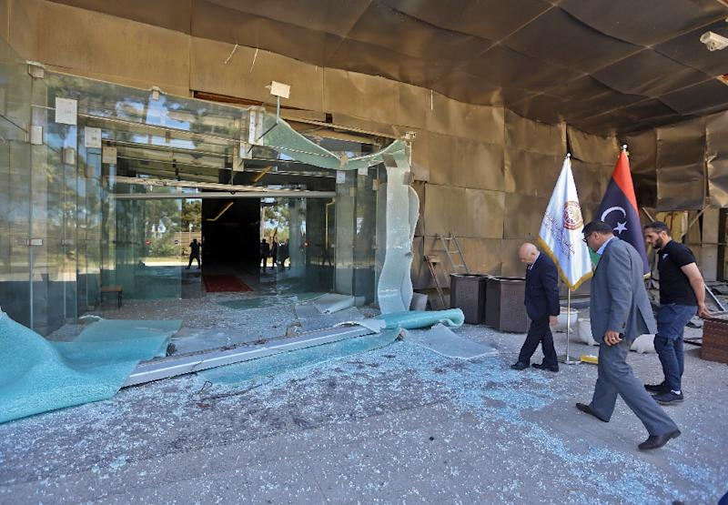 Sadeq al-Keheli (L), interim speaker for a faction of Libyan parliamentarians opposed to strongman Khalifa Haftar, inspects damage at a hotel serving as a HQ in Tripoli