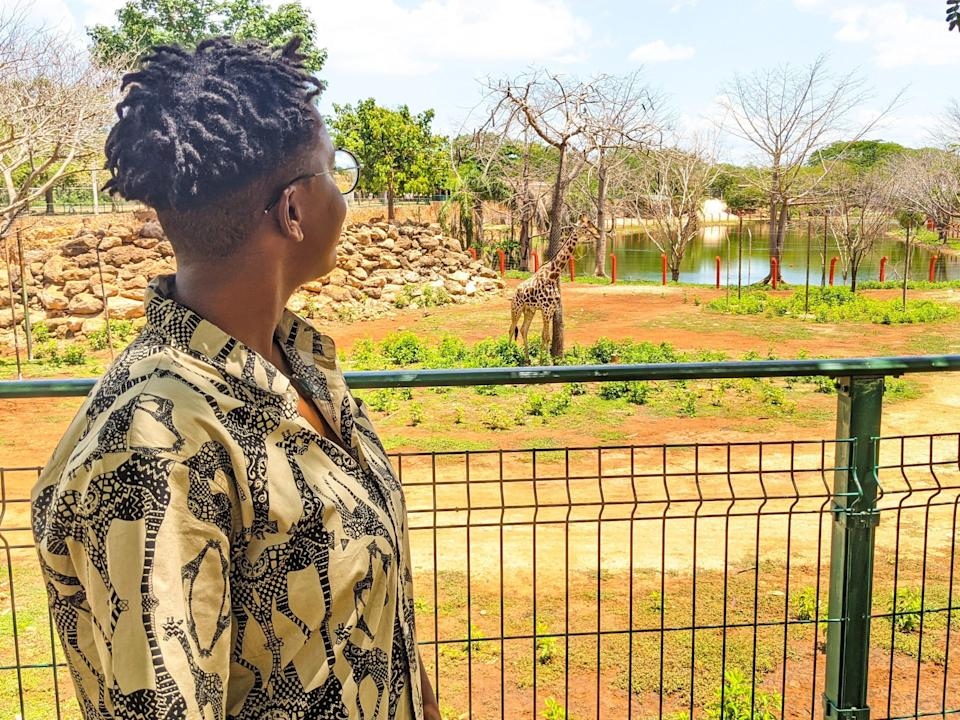 A woman looking at giraffes in an enclosureAmber Blackmon for Insider