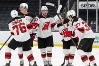 New Jersey Devils' Pavel Zacha (37) celebrates his goal with teammates, from left, P.K. Subban, Mikhail Maltsev, Dmitry Kulikov and Kyle Palmieri during the third period of an NHL hockey game against the Boston Bruins, Sunday, March 7, 2021, in Boston. (AP Photo/Michael Dwyer)