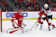 Detroit Red Wings goaltender Jonathan Bernier (45) stops a shot by New Jersey Devils left wing Miles Wood (44) during the first period of an NHL hockey game Friday, March 29, 2019, in Detroit. (AP Photo/Paul Sancya)