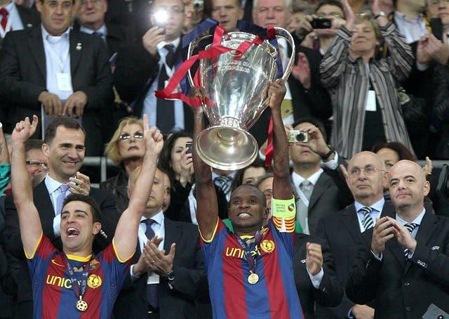 Eric Abidal lifts the Champions League