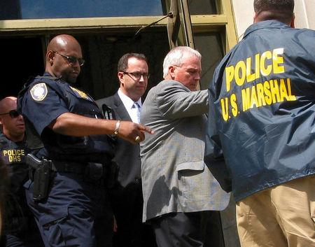 FILE PHOTO:    Fogle is led from federal court in Indianapolis, Indiana