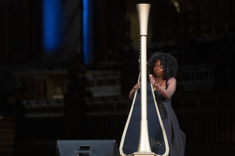 Harpist Brandee Younger performs during the Celebration of the Life of Toni Morrison, Thursday, Nov. 21, 2019, at the Cathedral of St. John the Divine in New York. (AP Photo/Mary Altaffer)