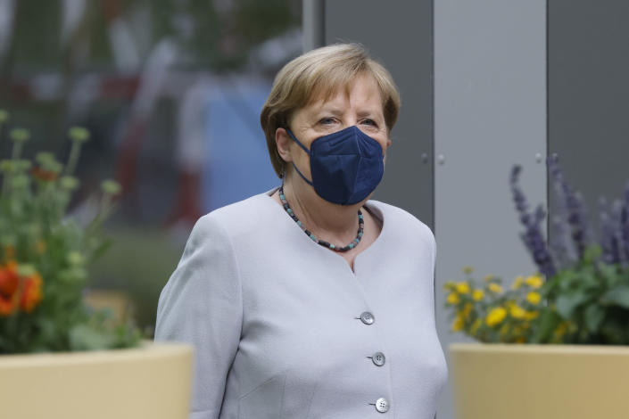 German Chancellor Angela Merkel arrives for a leadership meeting of the Christian Democratic Union (CDU) and the Bavarian Christian Social Union (CSU) in Berlin, Sunday June 20, 2021, on the eve of the unveiling of their electoral program ahead of the September general election. (Odd Andersen/Pool via AP)