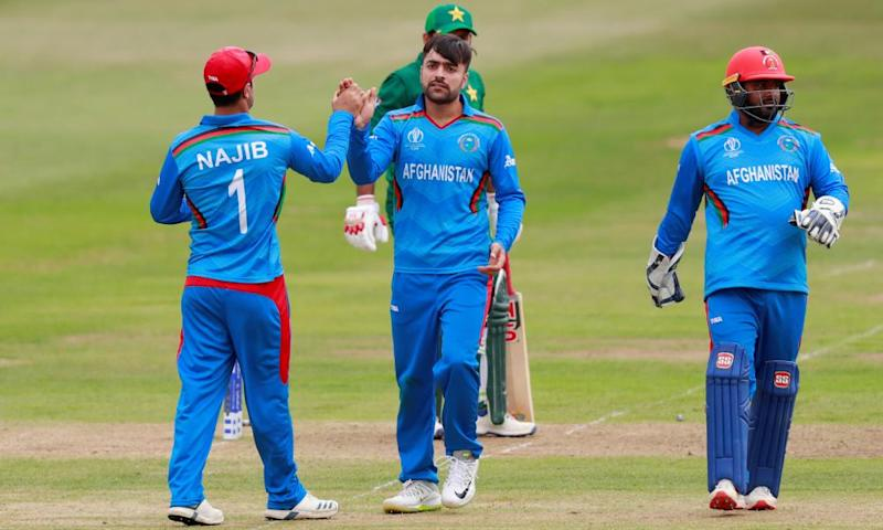 Afghanistan's Rashid Khan (centre) celebrates a wicket during Friday's win over Pakistan.