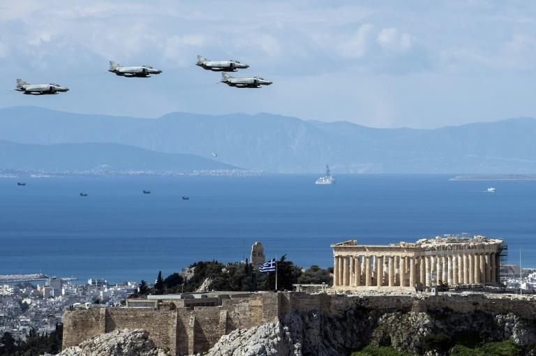A parade of tanks, artillery and overflying jets and helicopters marked the occasion in the capital