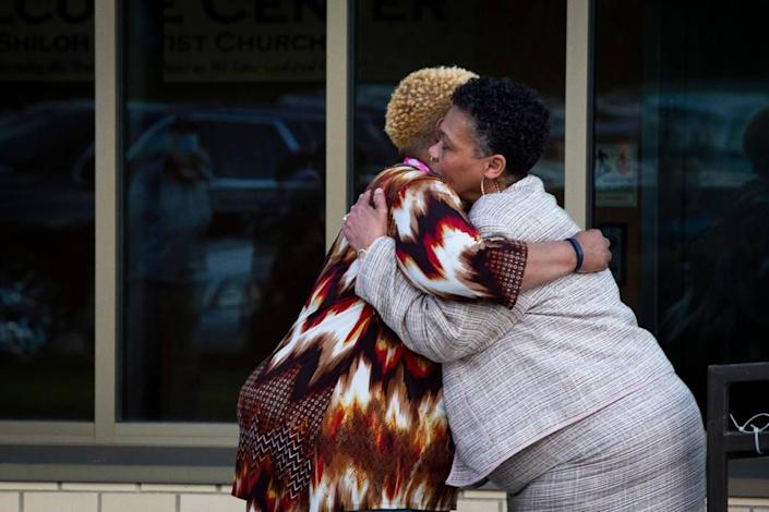 Andrea Washington-Mayberry (right), aunt of Lowell Washington who was killed on April 7, 2021 and grandmother of Mykel Waide who was killed on Aug. 16, 2020, hugs Cheryl Birch, mother of 22-year-old Jermaine Birch who was killed on Sept. 29, 2009, during the drive-in ÒStop the ViolenceÓ rally and symbolic funeral procession at Shiloh Baptist Church in Lexington, Ky., on Tuesday, April 20, 2021.