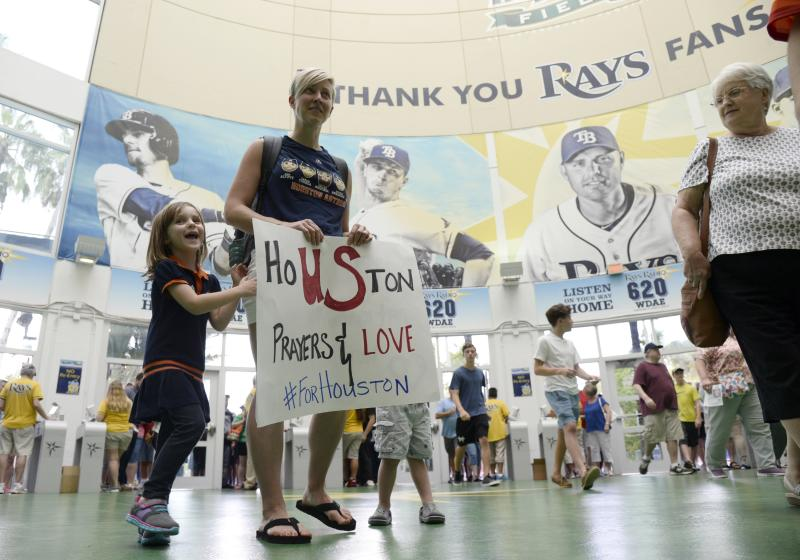 Fans show their support for Houston before Tuesday's game between the Astros and Rangers in St. Petersburg. (AP)
