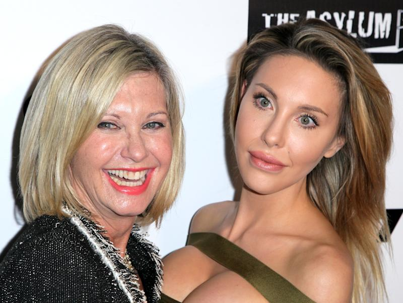 "Singer Olivia Newton-John and her daughter Chloe Lattanzi on the red carpet for the Premiere of Syfy's ""Dead 7"" at Harmony Gold on April 1, 2016"