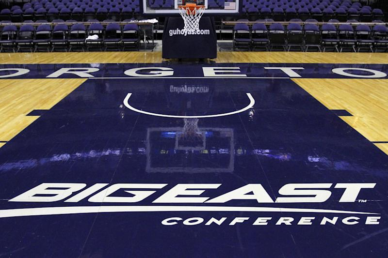 FILE - In this Dec. 15, 2012, file photo, a Big East Conference logo is displayed on the court after Georgetown played Western Carolina in an NCAA college basketball game at the Verizon Center in Washington. Big East football schools will get almost all of a $110 million pot in a deal that will allow seven departing basketball schools to keep the name Big East and start playing in their own conference next season, a person familiar with the negotiations says. The basketball schools, which include Georgetown, St. John's, Villanova, Seton Hall, Providence, Marquette and DePaul, will receive $10 million, keep the conference name and the right to play their conference tournament at Madison Square Garden. (AP Photo/Jacquelyn Martin, File)