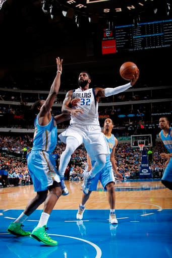 DALLAS, TX - APRIL 12: O.J. Mayo #32 of the Dallas Mavericks goes in for the lay up against Kenneth Faried #35 of the Denver Nuggets on April 12, 2013 at the American Airlines Center in Dallas, Texas. (Photo by Glenn James/NBAE via Getty Images)