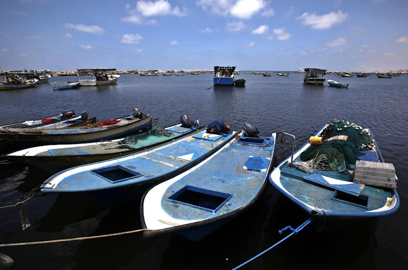 In this photo taken on Wednesday, July 31, 2013, Palestinian boats wait to sail at the fishermen sea port in Gaza City. Regime change in Egypt has cost the Hamas rulers of Gaza their most important foreign ally, and ordinary Palestinians are being caught up in the animosity. Many Gazans were laid off after Egypt closed the territory's border, and Palestinians living in Egypt are keeping a low profile for fear of being targeted in the backlash against Hamas. AP Photo/Adel Hana)
