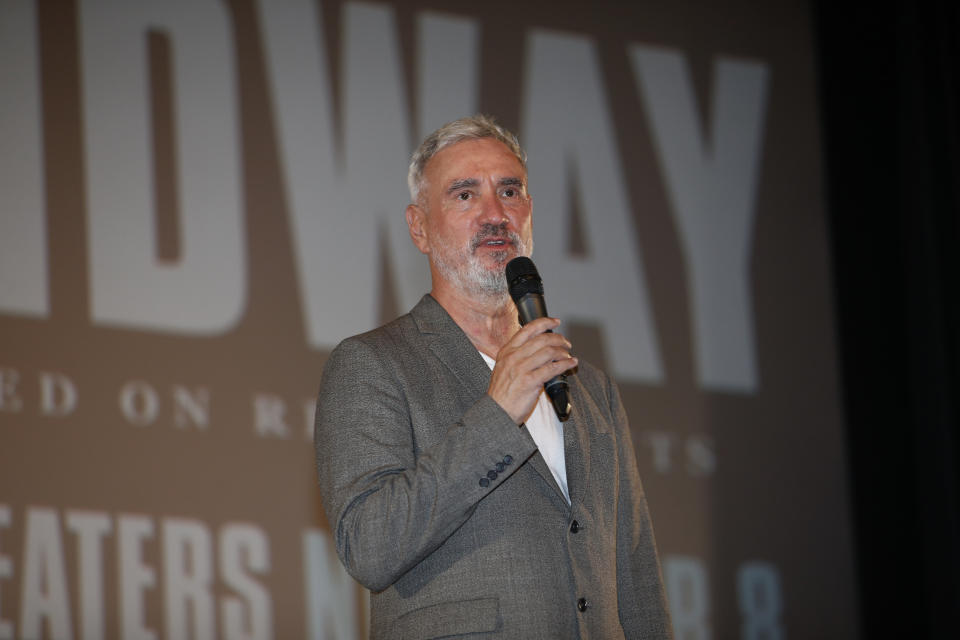 """Roland Emmerich speaks before the """"Midway"""" screening at Joint Base Pearl Harbor-Hickam on October 20, 2019. (Photo by Marco Garcia/Getty Images for Lionsgate Entertainment)"""