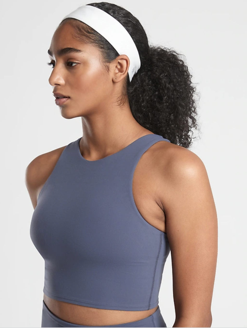"""<p><strong>Athleta</strong></p><p>athleta.gap.com</p><p><strong>$14.00</strong></p><p><a href=""""https://go.redirectingat.com?id=74968X1596630&url=https%3A%2F%2Fathleta.gap.com%2Fbrowse%2Fproduct.do%3Fpid%3D779294152%26cid%3D1013846%26pcid%3D1013846%26vid%3D1%26nav%3Dmeganav%253AAccessories%253ACATEGORIES%253AHats%2B%2526%2BHeadbands%26grid%3Dpds_49_53_1%26cpos%3D49%26cexp%3D1501%26kcid%3DCategoryIDs%253D1013846%26cvar%3D11273%26ctype%3DListing%26cpid%3Dres2011181011551301931753%23pdp-page-content&sref=https%3A%2F%2Fwww.cosmopolitan.com%2Fstyle-beauty%2Ffashion%2Fg37024274%2Fworkout-headbands%2F"""" rel=""""nofollow noopener"""" target=""""_blank"""" data-ylk=""""slk:Shop Now"""" class=""""link rapid-noclick-resp"""">Shop Now</a></p><p>This stretchy headband will keep your hair from getting in the way of your workouts, while still sitting comfortably on your head.</p>"""