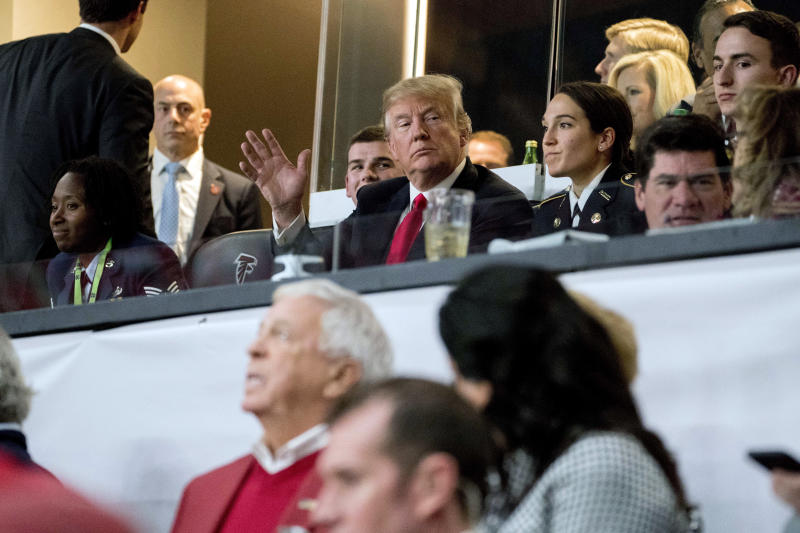 President Donald Trump waves to members of the media while watching the NCAA National Championship game at Mercedes-Benz Stadium, Monday, Jan. 8, 2018, in Atlanta, between Alabama and Georgia. (AP Photo/Andrew Harnik)