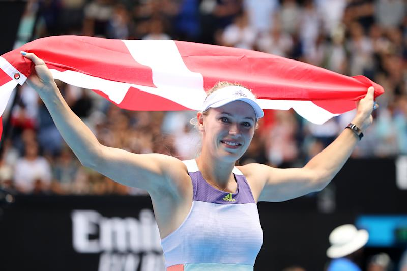MELBOURNE, AUSTRALIA - JANUARY 24: Caroline Wozniacki of Denmark drapes a Danish flag over her shoulders after losing her Women's Singles third round match against Ons Jabeur of Tunisia on day five of the 2020 Australian Open at Melbourne Park on January 24, 2020 in Melbourne, Australia. (Photo by Mark Kolbe/Getty Images)