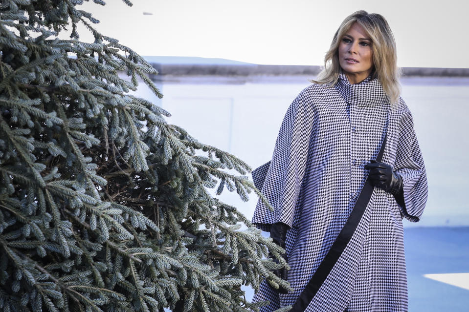 Melania Trump in a gingham coat inspecting the White House Christmas Tree