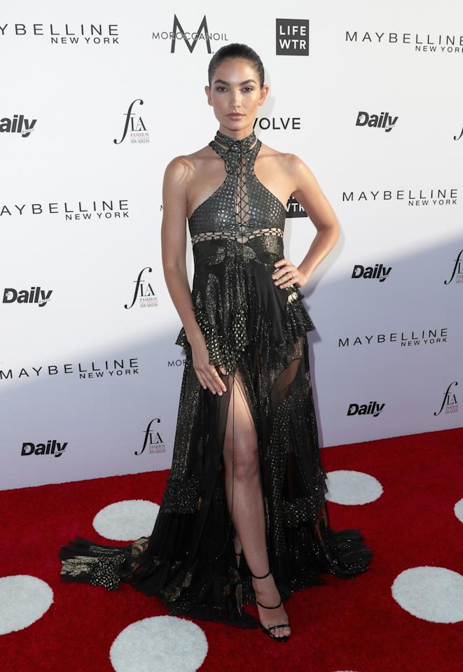 <div>The model stunned in a ruffled gypsy gown by Roberto Cavalli.<br /><i>[Photo: Getty]</i> </div>