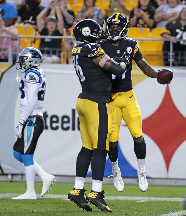 Pittsburgh Steelers wide receiver Tevin Jones , right, celebrates his touchdown catch with offensive tackle Chuks Okorafor (76) during the first half of a preseason NFL football game against the Carolina Panthers in Pittsburgh, Thursday, Aug. 30, 2018. (AP Photo/Keith Srakocic)