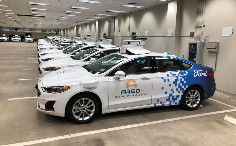 FILE PHOTO: A row of Ford Fusion Hybrid sedans outfitted with sensors and other self-driving equipment in Argo's test garage