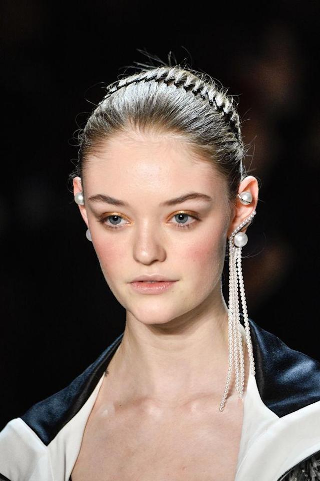 <p>Pearl ear cuff and long strand pearl earring at the Prabal Gurung FW18 show. (Photo: Getty) </p>