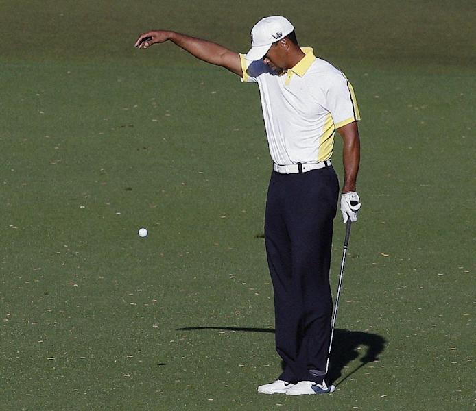 """FILE - In this April 12, 2013 file photo, Tiger Woods takes a drop on the 15th hole after his ball went into the water during the second round of the Masters golf tournament in Augusta, Ga. Golf Channel analyst Brandel Chamblee says he insinuated that Tiger Woods cheated and gave the world's No. 1 player an """"F"""" for his five-win season in a column he wrote for Golf.com because """"ethics matter more than athletics."""" (AP Photo/Charlie Riedel, File)"""
