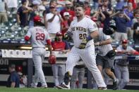Milwaukee Brewers' Daniel Vogelbach celebrates after hitting a walk-off grand slam during the ninth inning of a baseball game against the St. Louis Cardinals Sunday, Sept. 5, 2021, in Milwaukee. The Brewers won 6-5. (AP Photo/Morry Gash)