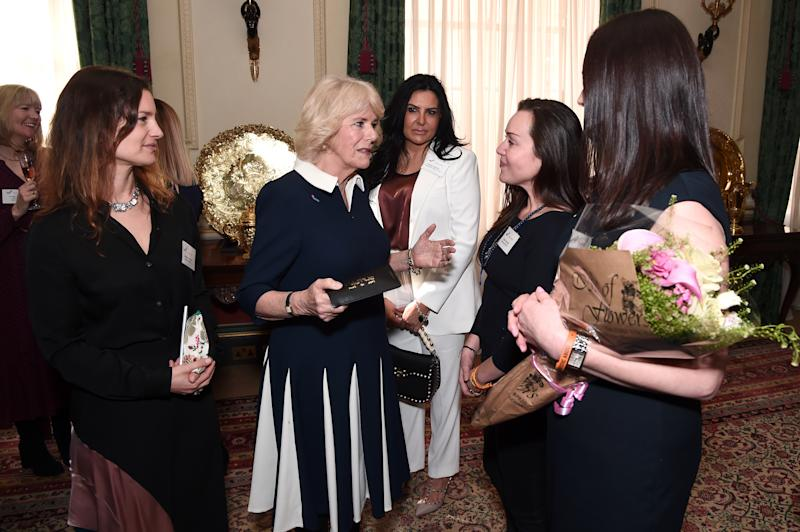 LONDON, ENGLAND - FEBRUARY 12: Camilla, Duchess of Cornwall (2nd L) talks to CEO of SafeLives Suzanne Jacob (L), Ambassador Women's Trust Teresa Falcone and SafeLives Pioneers Celia Peachey and Rachel Williams during a reception to acknowledge the 15th anniversary of domestic abuse charity SafeLives at Clarence House on February 12, 2020 in London, England. (Photo by Eamonn M. McCormack/Getty Images)